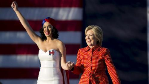 Democratic presidential candidate Hillary Clinton arrives with singer Katy Perry during a campaign rally with her husband, former President Bill Clinton, in Des Moines, Iowa, October 24, 2015. REUTERS/Scott Morgan