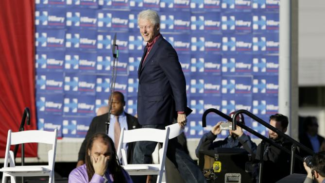 Former president Bill Clinton walks on stage before speaking during a rally for his wife, Democratic presidential candidate Hillary Rodham Clinton, before the Iowa Democratic Party's Jefferson-Jackson Dinner, Saturday, Oct. 24, 2015, in Des Moines, Iowa. (AP Photo/Charlie Neibergall)