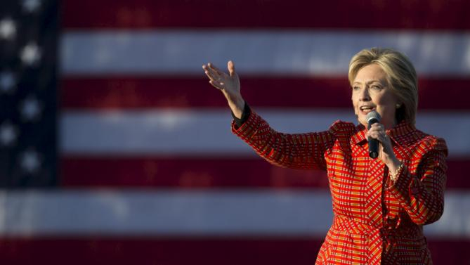 Democratic presidential candidate Hillary Clinton speaks during a campaign rally with her husband former President Bill Clinton and singer Katy Perry in Des Moines, Iowa, October 24, 2015. REUTERS/Scott Morgan