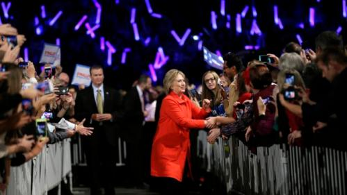 Democratic presidential candidate Hillary Rodham Clinton makes her way to the stage during the Iowa's Democratic party Jefferson-Jackson fundraiser dinner Saturday, Oct. 24, 2015, in Des Moines, Iowa. (AP Photo/Charlie Neibergall)