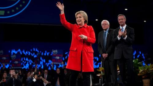 Democratic presidential candidates (L-R) Hillary Clinton, Bernie Sanders, and Martin O'Malley, greet the crowd at the Jefferson-Jackson Dinner in Des Moines, Iowa on October 24, 2015. REUTERS/Mark Kauzlarich