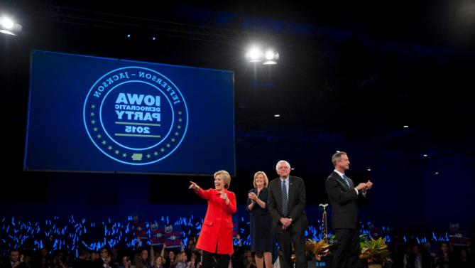(L-R) Hillary Clinton, Iowa Democratic Chairwoman Andy McGuire, Bernie Sanders, and Martin O'Malley, greet the crowd at the Jefferson-Jackson Dinner in Des Moines, Iowa on October 24, 2015. REUTERS/Mark Kauzlarich