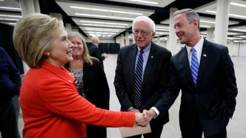 Democratic presidential candidates Hillary Rodham Clinton, left, Sen. Bernie Sanders, I-Vt., and former Maryland Gov. Martin O'Malley, right, talk backstage before the start of the Iowa Democratic Party's Jefferson-Jackson Dinner, Saturday, Oct. 24, 2015, in Des Moines, Iowa. (AP Photo/Charlie Neibergall)