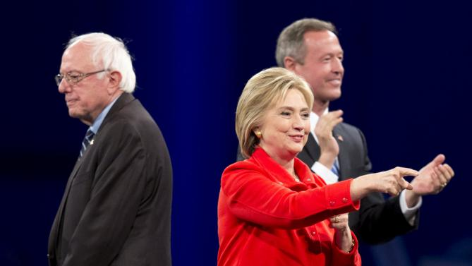 Democratic presidential candidates Bernie Sanders (L), Hillary Clinton (C) and Martin O'Malley are introduced at the 2015 Jefferson-Jackson Dinner in Des Moines, Iowa, October 24, 2015. REUTERS/Scott Morgan