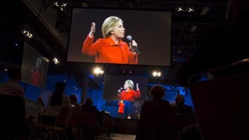Democratic presidential candidate Hillary Clinton speaks during the 2015 Jefferson-Jackson Dinner with fellow candidates Martin O'Malley and Bernie Sanders in Des Moines, Iowa, October 24, 2015. REUTERS/Scott Morgan TPX IMAGES OF THE DAY