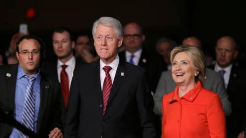 Former President Bill Clinton and his wife, Democratic presidential candidate Hillary Rodham Clinton, walk back to the stage after the Iowa Democratic Party's Jefferson-Jackson fundraising dinner, Saturday, Oct. 24, 2015, in Des Moines, Iowa. (AP Photo/Charlie Neibergall)