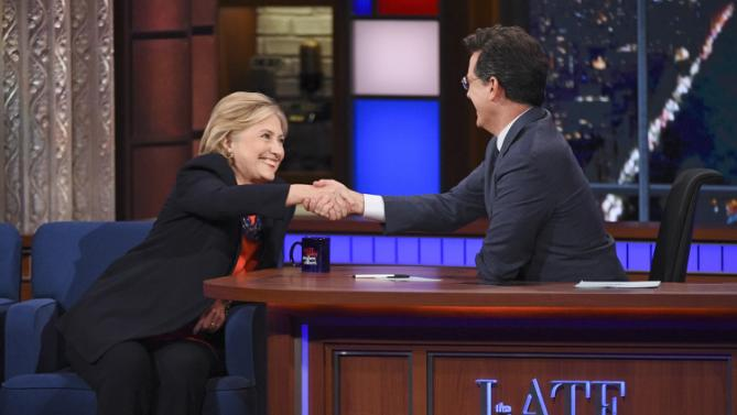 "In this image released by CBS, Democratic Presidential candidate Hillary Clinton, left, shakes hands with host Stephen Colbert during a taping of ""The Late Show with Stephen Colbert,"" Tuesday Oct. 27, 2015, in New York. (Jeffrey R. Staab/CBS via AP)"