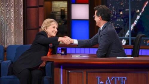"""In this image released by CBS, Democratic Presidential candidate Hillary Clinton, left, shakes hands with host Stephen Colbert during a taping of """"The Late Show with Stephen Colbert,"""" Tuesday Oct. 27, 2015, in New York. (Jeffrey R. Staab/CBS via AP)"""