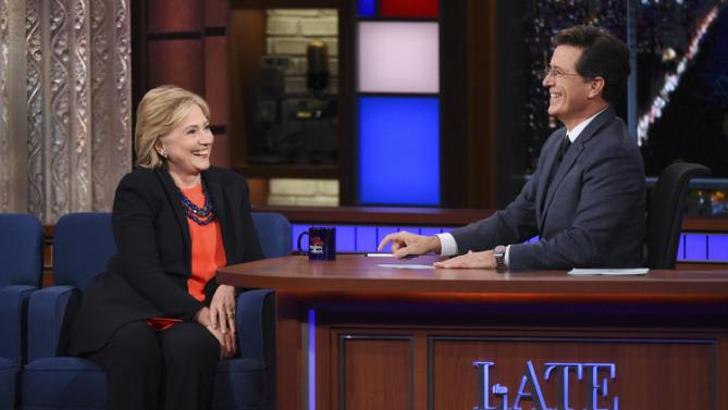 "In this image released by CBS, Democratic Presidential candidate Hillary Clinton, left, appears with host Stephen Colbert during a taping of ""The Late Show with Stephen Colbert,"" Tuesday Oct. 27, 2015, in New York. (Jeffrey R. Staab/CBS via AP)"