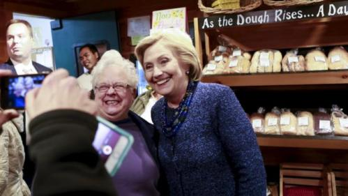 U.S. Democratic presidential candidate and former Secretary of State Hillary Clinton poses for a photo with a supporter at Moulton Farm in Meredith, New Hampshire October 28, 2015. REUTERS/Katherine Taylor