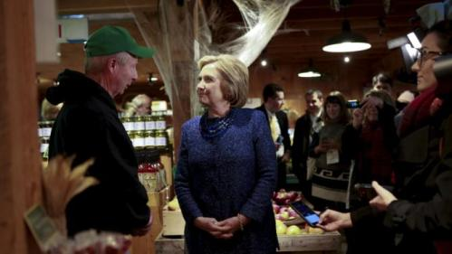 U.S. Democratic presidential candidate and former Secretary of State Hillary Clinton speaks with John Moutlon, owner of Moulton Farm, in Meredith, New Hampshire October 28, 2015. REUTERS/Katherine Taylor