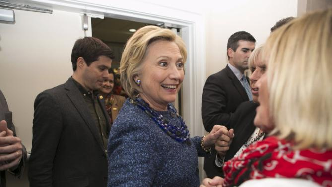 "U.S. Democratic presidential candidate and former Secretary of State Hillary Clinton shakes hands with guests at the ""Carroll County Democratic Committee's Annual Grover Cleveland Dinner"" at the Attitash Mountain Resort in Bartlett, New Hampshire October 28, 2015.   REUTERS/Katherine Taylor"