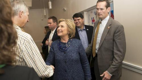 """U.S. Democratic presidential candidate and former Secretary of State Hillary Clinton shakes hands with a guest at the """"Carroll County Democratic Committee's Annual Grover Cleveland Dinner"""" at the Attitash Mountain Resort in Bartlett, New Hampshire October 28, 2015.   REUTERS/Katherine Taylor"""