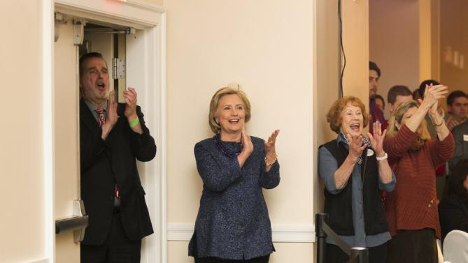 "U.S. Democratic presidential candidate and former Secretary of State Hillary Clinton claps with the crowd at the ""Carroll County Democratic Committee's Annual Grover Cleveland Dinner"" at the Attitash Mountain Resort in Bartlett, New Hampshire October 28, 2015. REUTERS/Katherine Taylor"