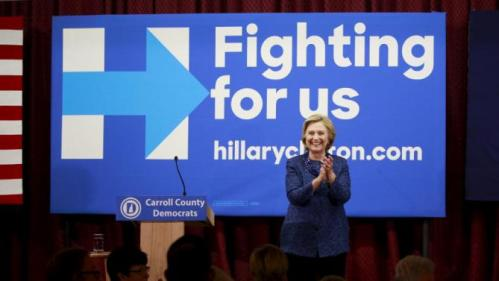 "U.S. Democratic presidential candidate and former Secretary of State Hillary Clinton applauds at the ""Carroll County Democratic Committee's Annual Grover Cleveland Dinner"" at the Attitash Mountain Resort in Bartlett, New Hampshire, October 28, 2015. REUTERS/Katherine Taylor"