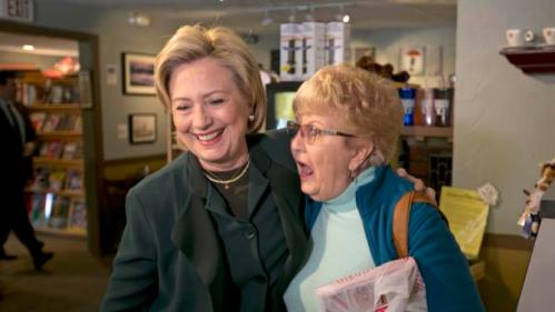 Democratic presidential candidate Hillary Rodham Clinton laughs with customer Sandra Medeiros at the White Mountain Cafe & Bookstore, Thursday, Oct. 29, 2015, in Gorham, N.H. (AP Photo/Robert F. Bukaty)