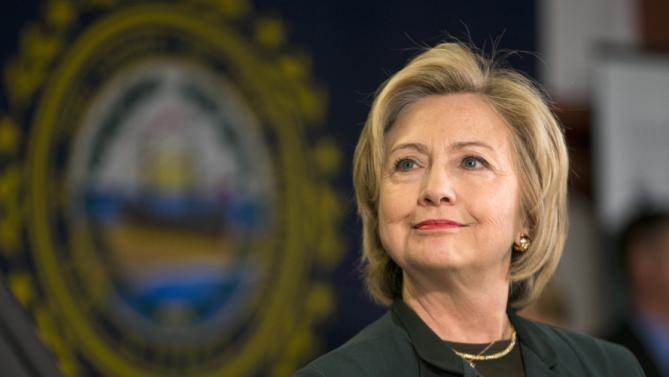 Democratic presidential candidate Hillary Rodham Clinton listens as she is introduced at a town hall meeting at White Mountain Community College, Thursday, Oct. 29, 2015, in Berlin, N.H. (AP Photo/Robert F. Bukaty)