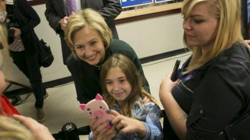 U.S. Democratic presidential candidate and former Secretary of State Hillary Clinton takes a selfie with 9 years old Katie Williamson of Franconia, New Hampshire at the Littleton Rural Economic Roundtable at Littleton High School in Littleton, New Hampshire October 29, 2015.   REUTERS/Katherine Taylor