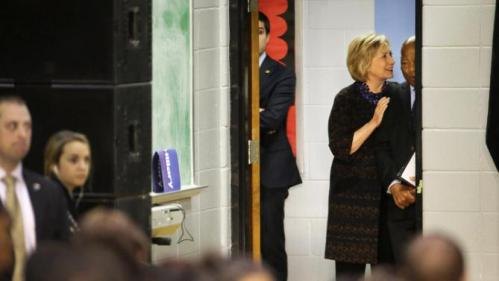 Democratic presidential candidate Hillary Rodham Clinton, left, talks with Rep. John Lewis, D-Ga., as they wait to be introduced backstage at a campaign event for Clinton at Clark Atlanta University in Atlanta, Friday, Oct. 30, 2015. (AP Photo/David Goldman)