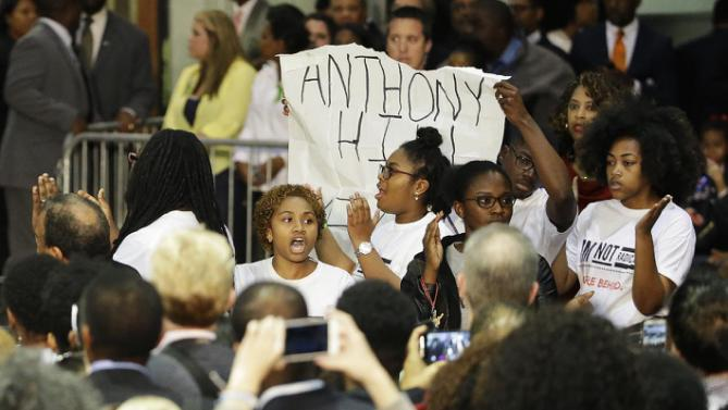 Protesters interrupt Democratic presidential candidate Hillary Rodham Clinton as she speaks during a campaign event at Clark Atlanta University in Atlanta, Friday, Oct. 30, 2015. (AP Photo/David Goldman)