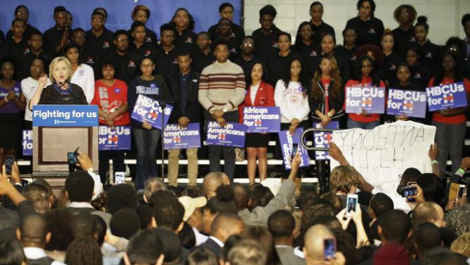 Protesters at right interrupt Democratic presidential candidate Hillary Rodham Clinton as she speaks during a campaign event at Clark Atlanta in Atlanta, University Friday, Oct. 30, 2015. (AP Photo/David Goldman)