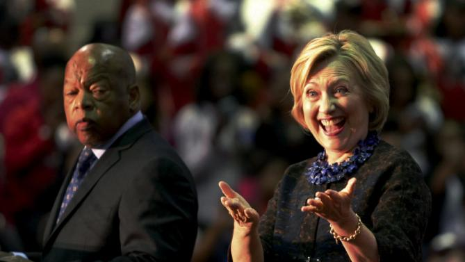 "U.S. Democratic presidential candidate Hillary Clinton reacts next to U.S. Congressman John Lewis (L) before speaking at the ""African Americans for Hillary"" rally at Clark Atlanta University in Atlanta, Georgia October 30 2015.   REUTERS/Tami Chappell"