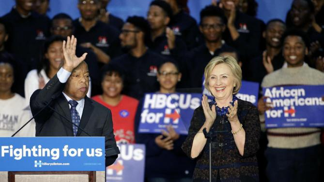 Democratic presidential candidate Hillary Rodham Clinton, right, and Rep. John Lewis, D-Ga., step onstage during a campaign event for Clinton at Clark Atlanta University Friday, Oct. 30, 2015, in Atlanta. (AP Photo/David Goldman)
