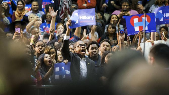 Supporters cheer for Democratic presidential candidate Hillary Rodham Clinton as she speaks over protesters interrupting her during a campaign event at Clark Atlanta University Friday, Oct. 30, 2015, in Atlanta. (AP Photo/David Goldman)