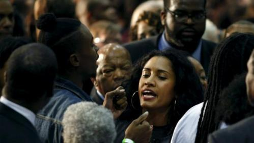 "A protestor (L) from ""Black Lives Matter"" is confronted during the speech of U.S. Democratic presidential candidate Hillary Clinton at an ""African Americans for Hillary"" rally at Clark Atlanta University in Atlanta, Georgia October 30, 2015. REUTERS/Tami Chappell"