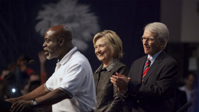 Ken Riley (L), President of the ILA local 1422, announces the union's national endorsement of U.S. Democratic presidential candidate Hillary Clinton (C) as Charleston Mayor Joe Riley (R) looks on before Clinton's speech to members of The International Longshoremen's Association in Charleston, South Carolina, October 31, 2015.  REUTERS/Randall Hill