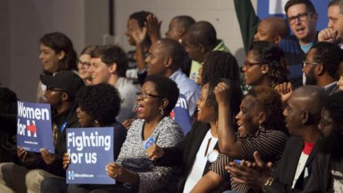 Supporters for U.S. Democratic presidential candidate Hillary Clinton cheer for the candidate at a speech for members of The International Longshoremen's Association in Charleston, South Carolina, October 31, 2015.  REUTERS/Randall Hill