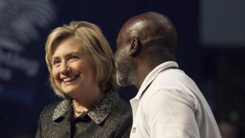 Ken Riley (R), president of the ILA Local 1422, talks to U.S. Democratic presidential candidate Hillary Clinton before announcing the union's national endorsement of Clinton to members of the International Longshoremen's Association in Charleston, South Carolina, October 31, 2015.  REUTERS/Randall Hill