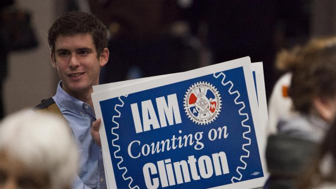 Jonathan Battaglia with the International Associaciation of Machinists, hands out signs before a speech by U.S. Democratic presidential candidate Hillary Clinton to members of The International Longshoremen's Association in Charleston, South Carolina, October 31, 2015.  REUTERS/Randall Hill
