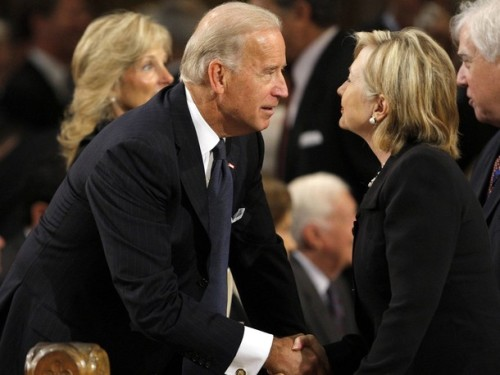 U.S. Vice President Joseph Biden talks with Secretary of State Hillary Clinton (R) during the funeral services for U.S. Senator Edward Kennedy at the Basilica of Our Lady of Perpetual Help in Boston, Massachusetts August 29, 2009. Senator Kennedy died late Tuesday after a battle with cancer. REUTERS/Brian Snyder (UNITED STATES POLITICS OBITUARY)