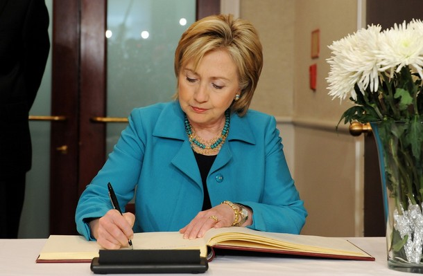 US Secretary of State Hillary Clinton signs a condolence book for late former South Korean president Roh Moo-Hyun as she pays her respect at the South Korean embassy in Washington, DC, on May 28, 2009. Roh, who was at the center of a multi-million-dollar corruption probe, plunged to his death off a mountainside on on May 23 in an apparent suicide. The 62-year-old Roh, who held office from 2003-2008 and was credited with striving to make South Korea more democratic, had left a suicide note before plunging to his death off a cliff, a former aide said. AFP PHOTO/Jewel SAMAD (Photo credit should read JEWEL SAMAD/AFP/Getty Images)