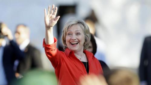 Democratic presidential candidate Hillary Rodham Clinton waves to supporter as she arrives at a town hall meeting, Tuesday, Nov. 3, 2015, in Coralville, Iowa. (AP Photo/Charlie Neibergall)