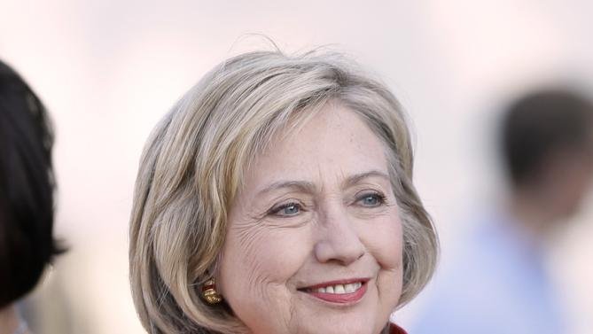 Democratic presidential candidate Hillary Rodham Clinton arrives at a town hall meeting, Tuesday, Nov. 3, 2015, in Coralville, Iowa. (AP Photo/Charlie Neibergall)