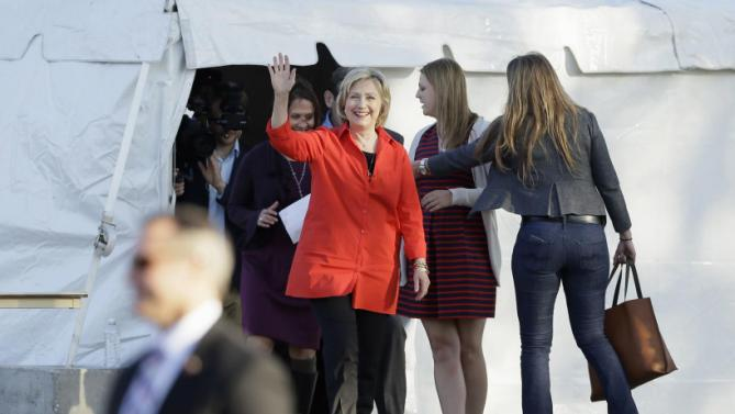Democratic presidential candidate Hillary Rodham Clinton waves as she arrives at a town hall meeting, Tuesday, Nov. 3, 2015, in Coralville, Iowa. (AP Photo/Charlie Neibergall)