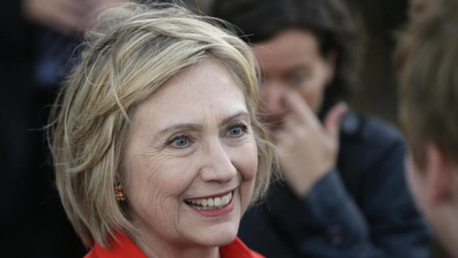 Democratic presidential candidate Hillary Rodham Clinton talks to supporters after a town hall meeting Tuesday, Nov. 3, 2015, in Coralville, Iowa. (AP Photo/Charlie Neibergall)