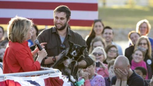 """Democratic presidential candidate Hillary Clinton meets Max Rubin of Iowa City and his dog, Clarabelle, who Rubin says has met seven presidential candidates, during the """"Fighting for Us"""" town hall event in Coralville, Iowa, November 3, 2015. REUTERS/Scott Morgan"""