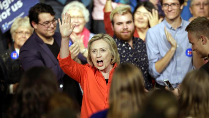 Democratic presidential candidate Hillary Rodham Clinton greets audience members before speaking during a town hall meeting at Grinnell College Tuesday, Nov. 3, 2015, in Grinnell, Iowa. (AP Photo/Charlie Neibergall)