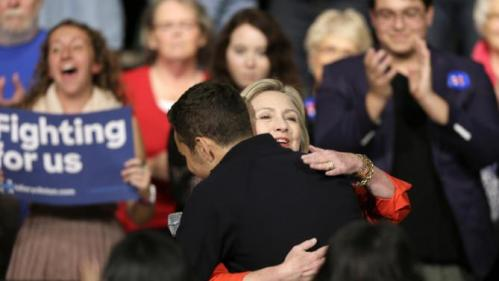 Democratic presidential candidate Hillary Rodham Clinton gets a hug from David Leitson after he introduced her to speak at a town hall meeting at Grinnell College Tuesday, Nov. 3, 2015, in Grinnell, Iowa. (AP Photo/Charlie Neibergall)
