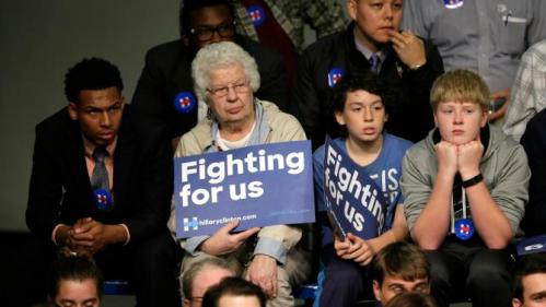 Audience members listen as Democratic presidential candidate Hillary Rodham Clinton speaks during a town hall meeting at Grinnell College Tuesday, Nov. 3, 2015, in Grinnell, Iowa. (AP Photo/Charlie Neibergall)