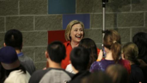 Democratic presidential candidate Hillary Rodham Clinton reacts to audience members as she arrives at a town hall meeting at Grinnell College Tuesday, Nov. 3, 2015, in Grinnell, Iowa. (AP Photo/Charlie Neibergall)