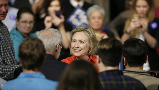 Democratic presidential candidate Hillary Rodham Clinton greets audience members during a town hall meeting at Grinnell College Tuesday, Nov. 3, 2015, in Grinnell, Iowa. (AP Photo/Charlie Neibergall)