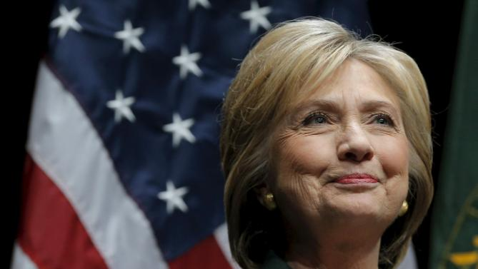 U.S. Democratic presidential candidate Hillary Clinton listens as she is introduced for a speech at the Center for Global Business and Government speaker series at Dartmouth College in Hanover, New Hampshire November 10, 2015.  REUTERS/Brian Snyder