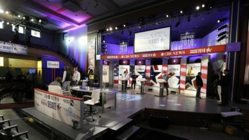 Workers stand at the podiums on stage during final preparations for Saturday night's Democratic presidential debate between Sen. Bernie Sanders, I-Vt,, Hillary Rodham Clinton and former Maryland Gov. Martin O'Malley, Friday, Nov. 13, 2015, in Des Moines, Iowa. (AP Photo/Charlie Neibergall)