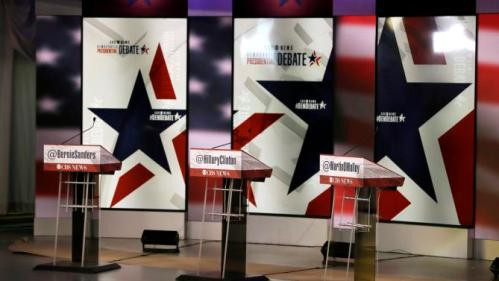 The podiums are seen on the stage during final preparations for Saturday night's Democratic presidential debate between Sen. Bernie Sanders, I-Vt,, Hillary Rodham Clinton and former Maryland Gov. Martin O'Malley, Friday, Nov. 13, 2015, in Des Moines, Iowa. (AP Photo/Charlie Neibergall)