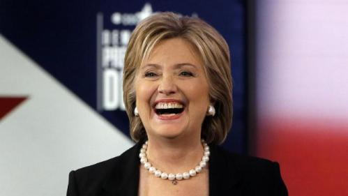 Hillary Rodham Clinton laughs during a commercial break at a Democratic presidential primary debate, Saturday, Nov. 14, 2015, in Des Moines, Iowa. (AP Photo/Charlie Neibergall)