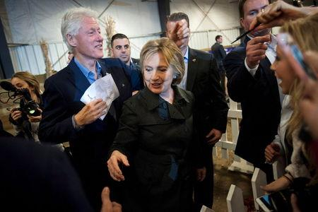 Democratic U.S. presidential candidate Hillary Clinton (R) and former U.S. President Bill Clinton greet supporters at the Central Iowa Democrats Fall Barbecue in Ames, Iowa November 15, 2015. REUTERS/Mark Kauzlarich